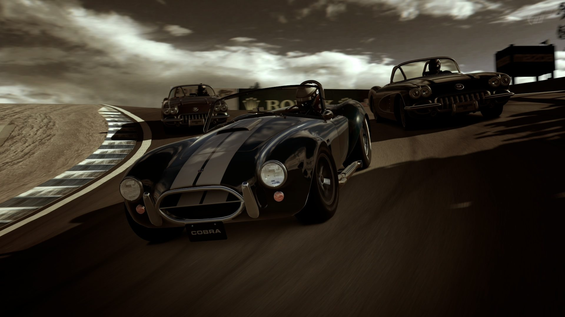 GT6 Cobra leads 2 Corvettes at Corkscrew.jpg