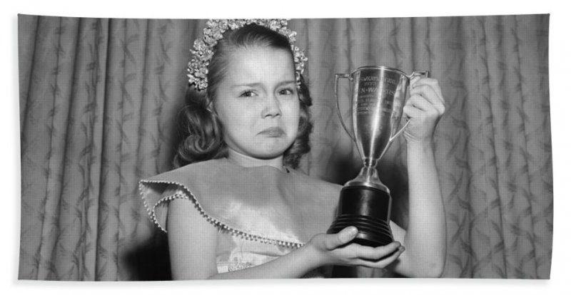 sad-girl-with-second-place-trophy-debrockeclassicstock.jpg